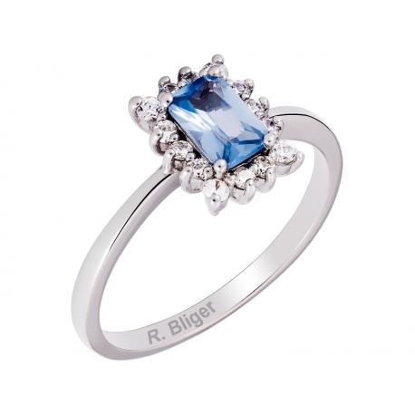 Pierścionek z białego złota zdobiony topazem niebieskim i cyrkoniami: GGR036