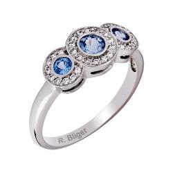 Pierścionek z białego złota zdobiony topazem niebieskim i cyrkoniami: GGR039
