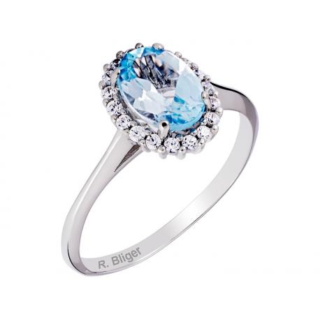 Pierścionek z białego złota zdobiony topazem niebieskim i cyrkoniami: GGR040